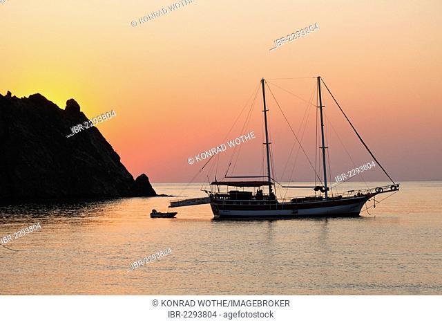 Sailboat on the sea at sunrise, Cirali, Lycian coast, the Aegean, Mediterranean Sea, Turkey, Asia Minor