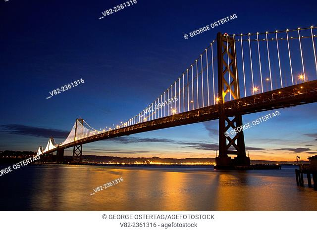 San Franciso-Oakland Bay Bridge at dawn, Rincon Park, Embarcadero, San Francisco, California