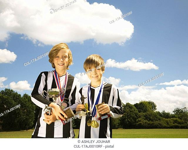 Boy footballers with Trophies