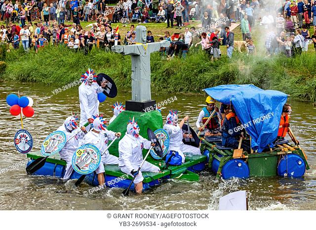 Lewes - Sussex, UK - 3/7/16. People Line The Banks Of The River Ouse To Watch and Also Throw Eggs and Flour At The Competing Rafts and Their Crews At The Annual...