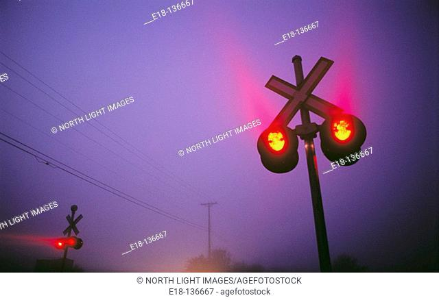 Railway crossing signals on foggy morning in Ladner. Vancouver, British Columbia, Canada