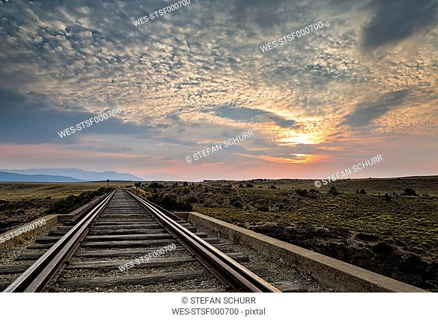 South America, Argentina, Patagonia, Province Rio Negro, near Nirihuau, Railway track at sunset