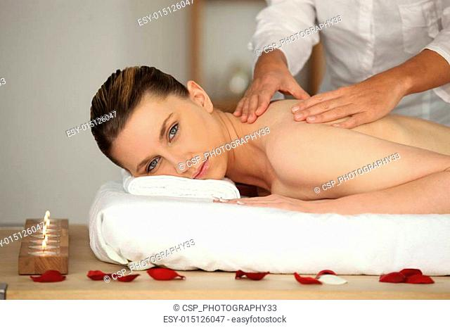 Relaxed woman having back massage