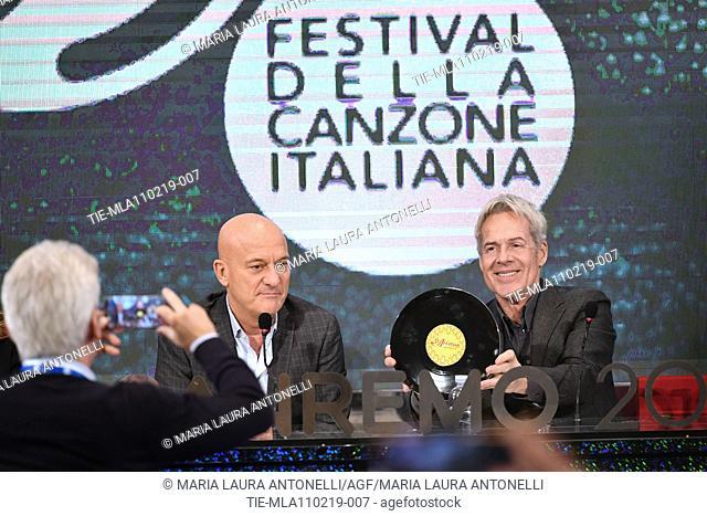 Claudio Bisio, Claudio Baglioni shows the award Teatro Ariston for the singer Loredana Berte' during the final press conference of 69th Sanremo Music Festival