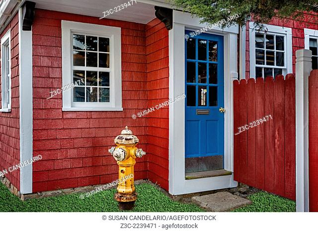 Picturesque storefront with fire hydrant at Bearskin Neck in Rockport, Massachusetts. Bearskin Neck is full of rustic little shops that is internationally known...