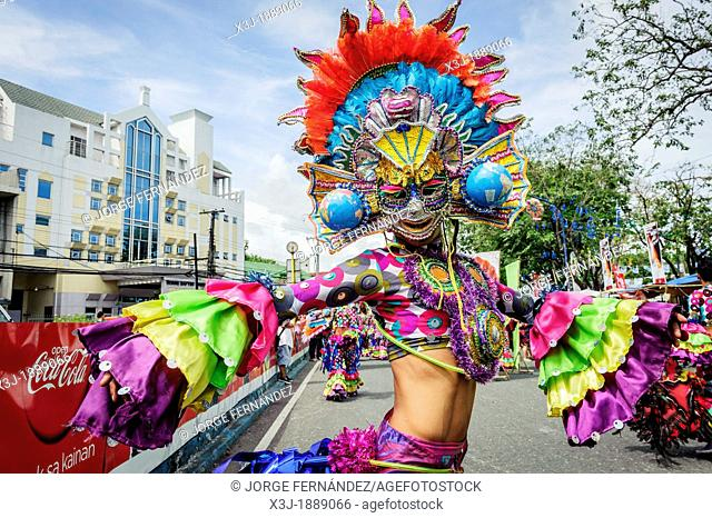 Participants of the parade during the celebration of Dinagyang in homage to 'The Santo Niño', the patron saint of many Philippino cities  Iloilo, Philippines