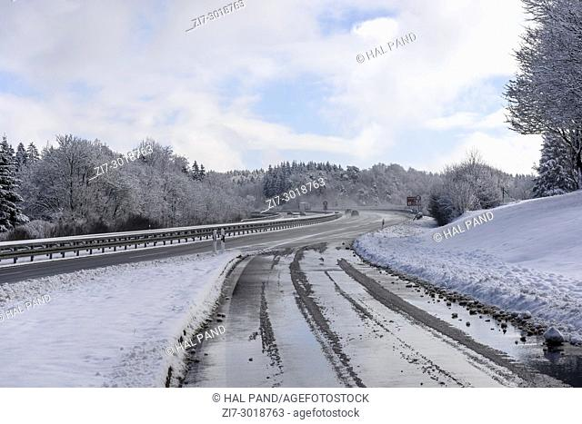 winter landscape with snowy German highway, shot in bright winter light in countryside near Hausen, Baden-Württemberg, Germany