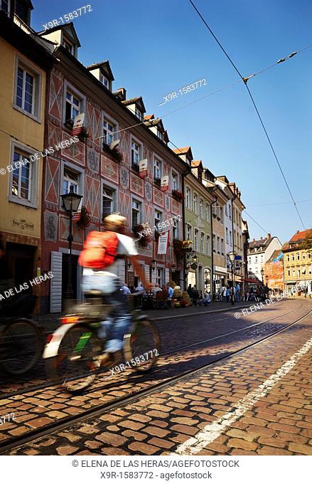 Cyclist passing by the Red Bear Hotel  Freiburg im Breisgau  Baden Wuerttemberg  Germany