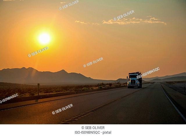 Truck travelling on the freeway at sunset, Utah, USA