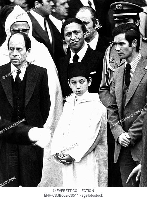 Morocco's crown Prince Sidi Mohammed at memorial services for French Pres. George Pompidou. April 6, 1974. At left is French Foreign Minister Michael Jobert
