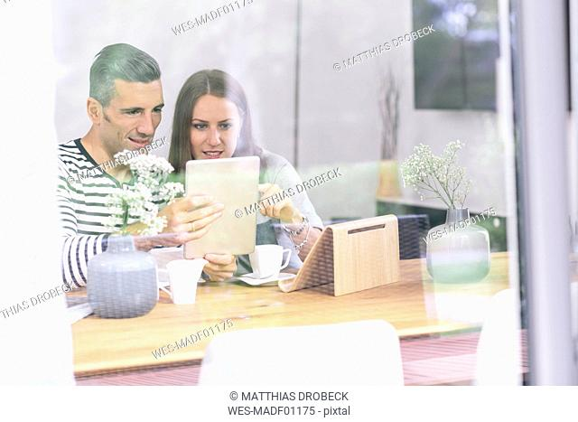 Couple at home using tablet