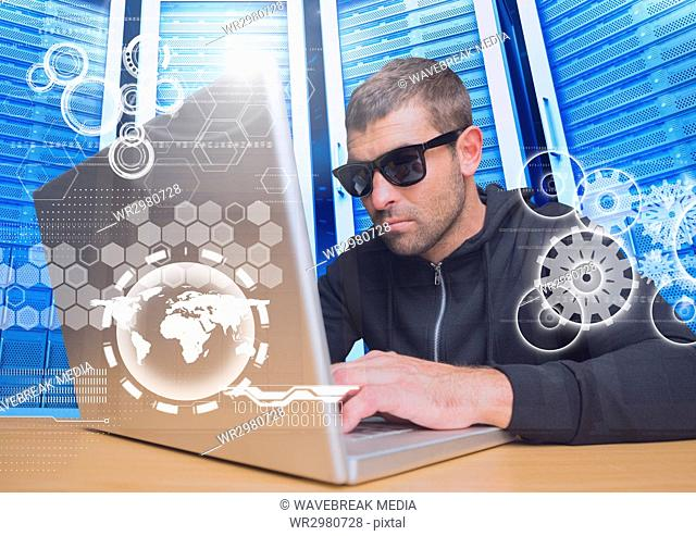 Hacker with sunglasses using a laptop in data center