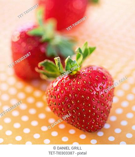 Close-up of strawberries on dotted background