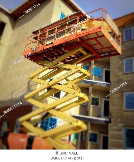 A scissor lift at a construction site in Florida