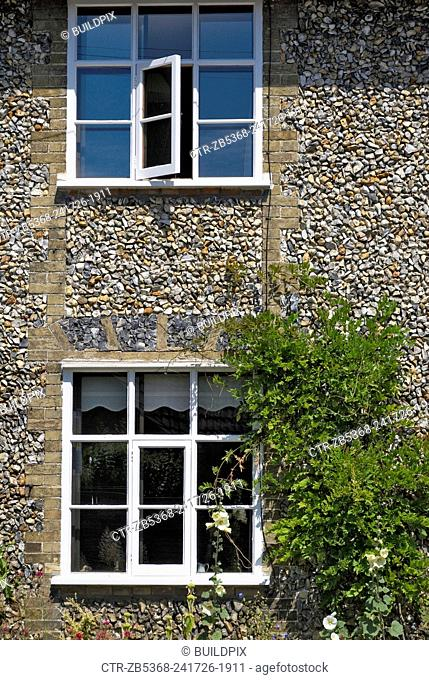 Windows of semi detached period cottage, Suffolk, UK