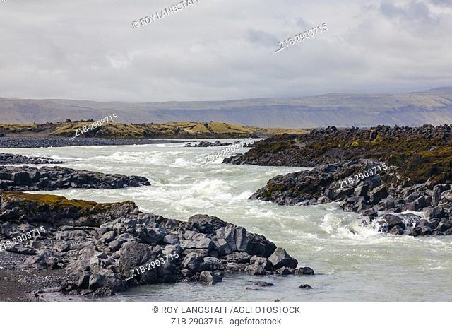 Fast flowing river cutting through an extensive lave field in southern Iceland