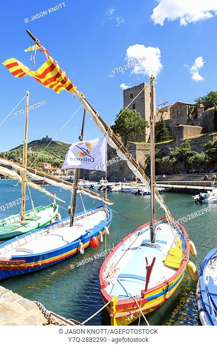 The Château Royal overlooking boats in the small harbour of Collioure, Côte Vermeille, Céret, Pyrénées-Orientales, Occitanie, France