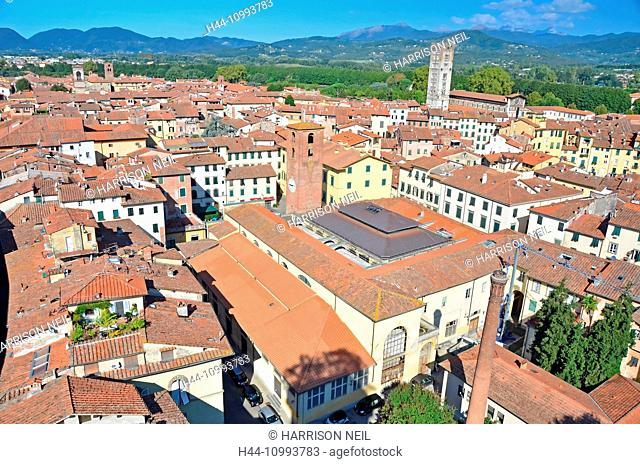 View over the roof tops of the medieval town of Lucca, Italy. In the background the Apennine mountains