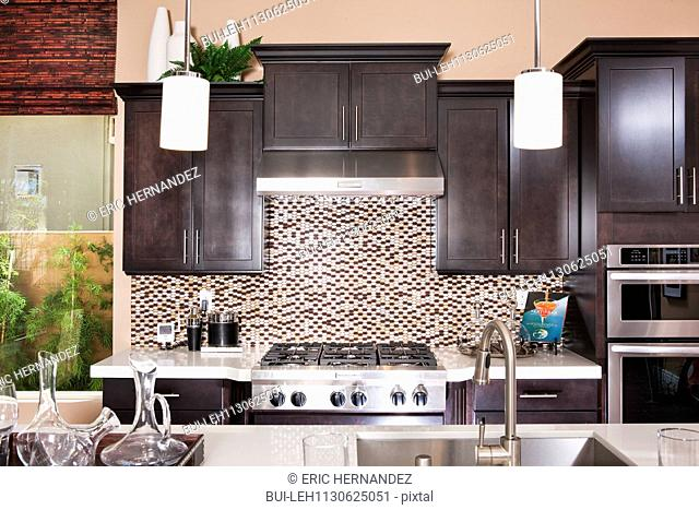 Interior of domestic kitchen with wooden cabinets; Rancho Mission Viejo; California; USA