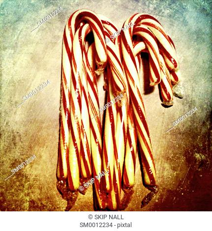 Christmas candy canes on a textured background