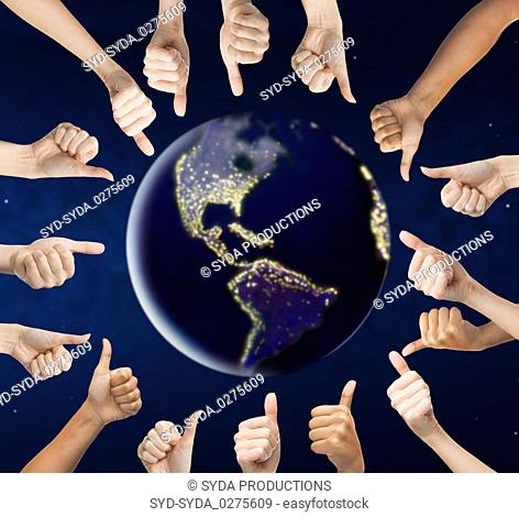 human hands showing thumbs up around earth planet