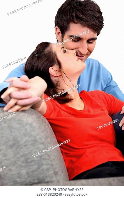 charming couple of newlyweds on sofa