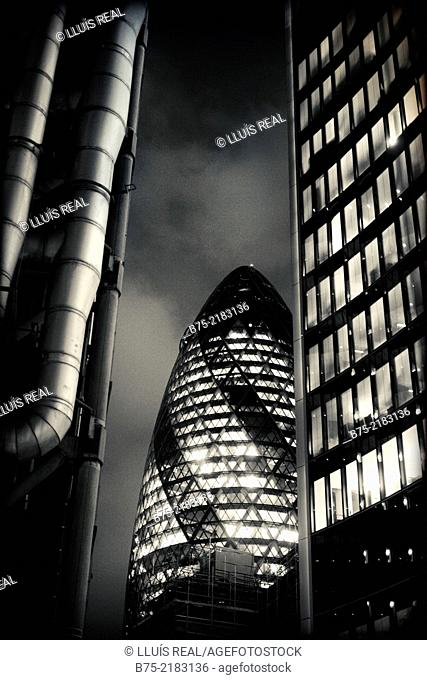 view of the Gherkin building between Lloyds bank and Willis building in City of London, England, UK