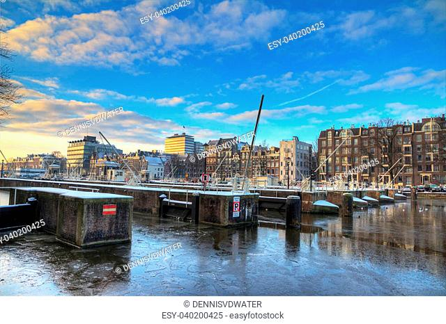 Beautiful winter view on the sluice gates in the river Amstel in Amsterdam, the Netherlands. HDR