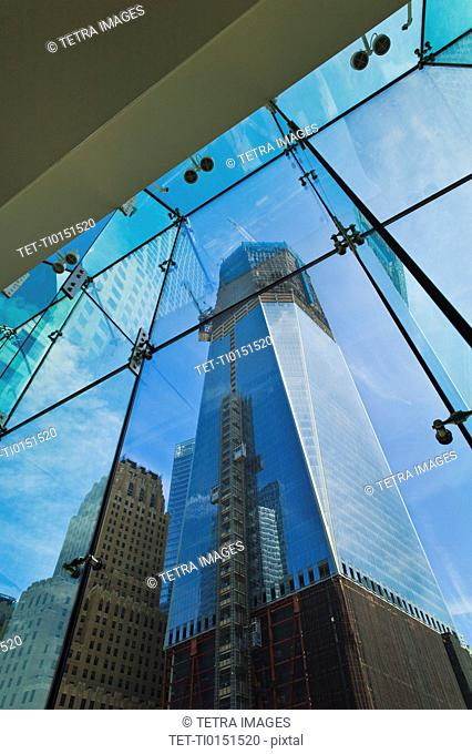 USA, New York, New York City, Lower Manhattan, Ground Zero, reflection of Freedom Tower in glass wall