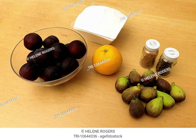 Ingredients for Christmas Jam Figs, Plums, Orange, Cloves, Cinnamon and Sugar