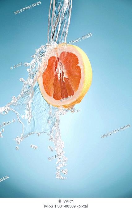 Water Pouring On A Fruit