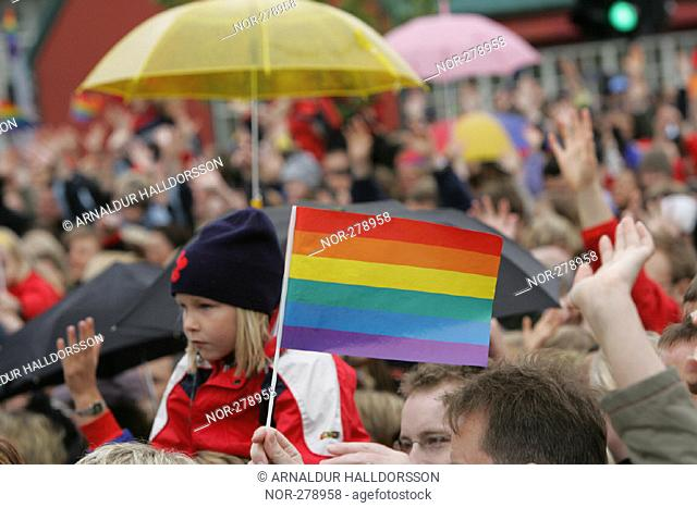 People with flags and umbrellas, celebrating Gay Pride Day in Reykjavik