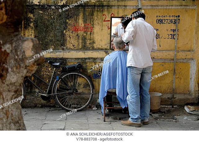 Street barber in the old town of Hanoi