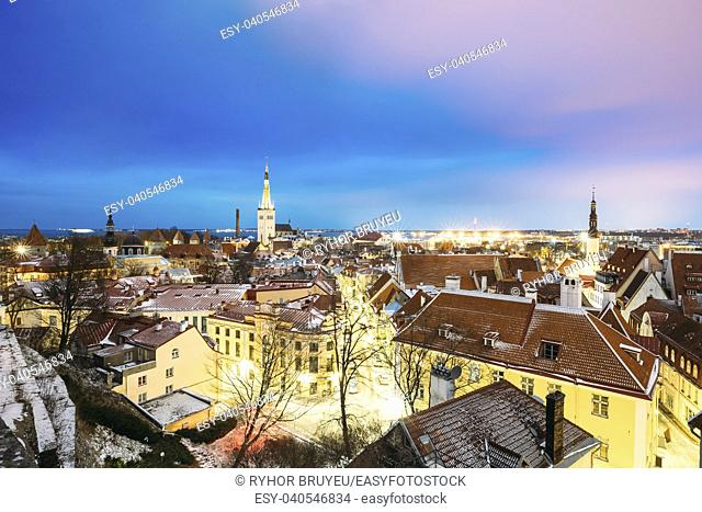 Traditional Old Ancient Architecture Cityscape In Historic District Of Tallinn, Estonia. Winter Evening Night. Famous Landmark. Destination Scenic