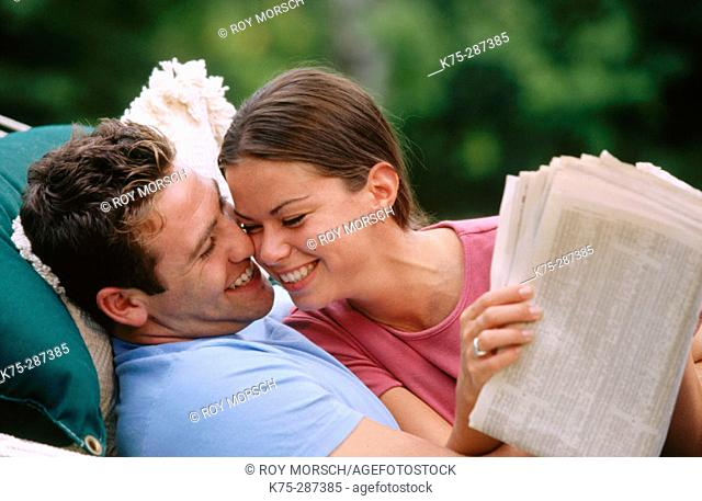 Laughing and reading the newspaper together