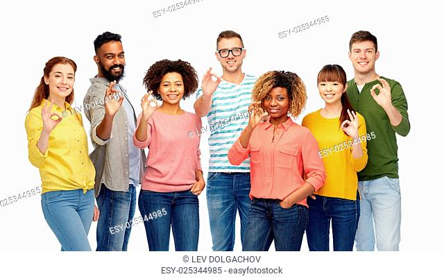 diversity, race, ethnicity and people concept - international group of happy smiling men and women showing ok hand sign over white