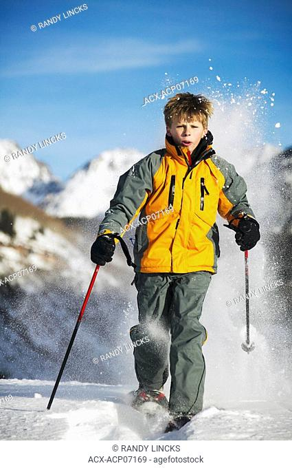 Snowshoeing boy at Whistler, British Columbia, Canada