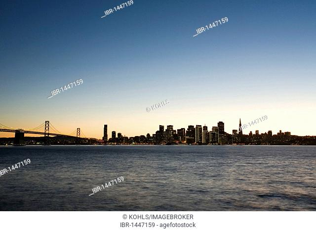 View from Treasure Island to San Francisco skyline, Oakland Bay Bridge, at twilight, California, United States of America