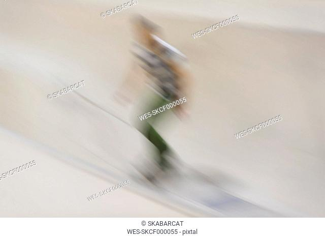 Blurred skateboarding man