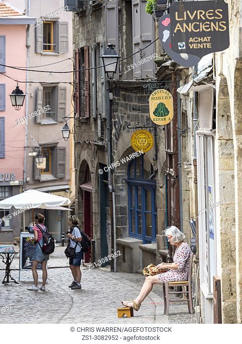 A lady sat making lace in the street Le Puy en Velay Haute-Loire Auvergne-Rhône-Alpes France