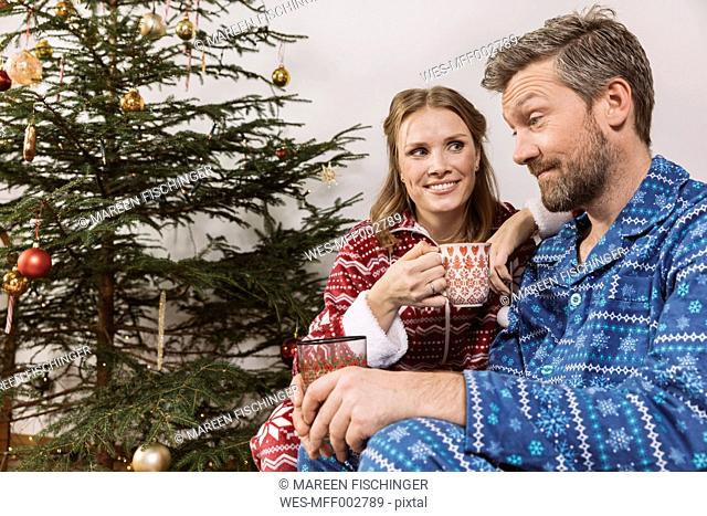 Tired couple in Christmas pyjamas