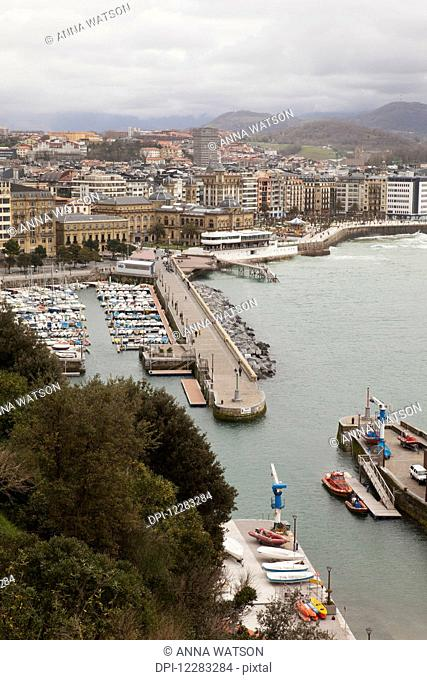 Harbour and La Concha bay at high tide; San Sebastian, Spain