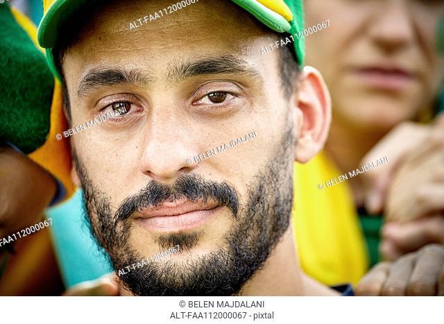 Football fan with tears in his eyes, portrait