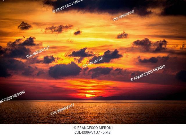 Seascape with sunset on horizon, Camogli, Liguria, Italy