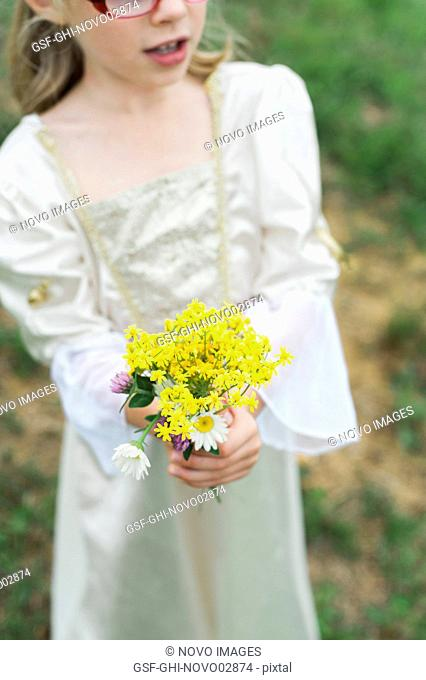 Young Girl Dressed as Princess Holding Bouquet of Flowers