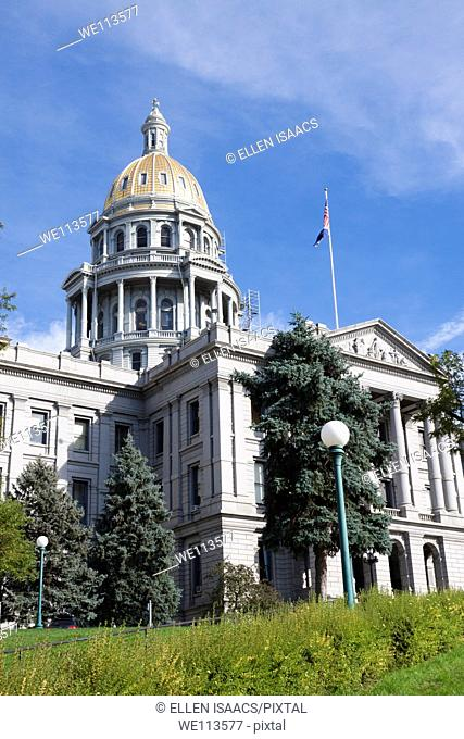 Gold dome and front entrance to Colorado state capitol building or statehouse in Denver