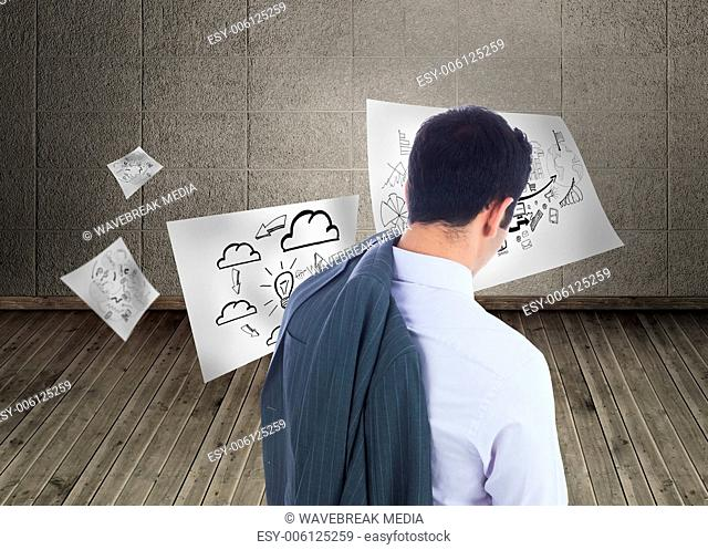 Composite image of businessman standing