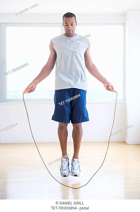 Young man skipping rope