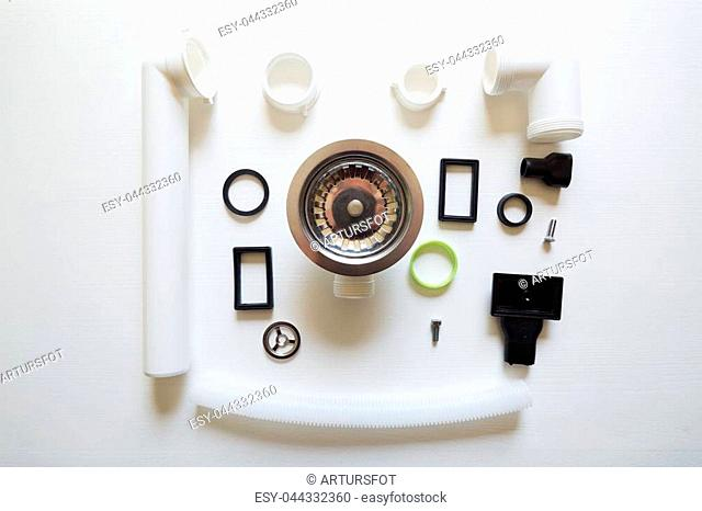 Different hardware elements and tubes for a kitchen sink drain