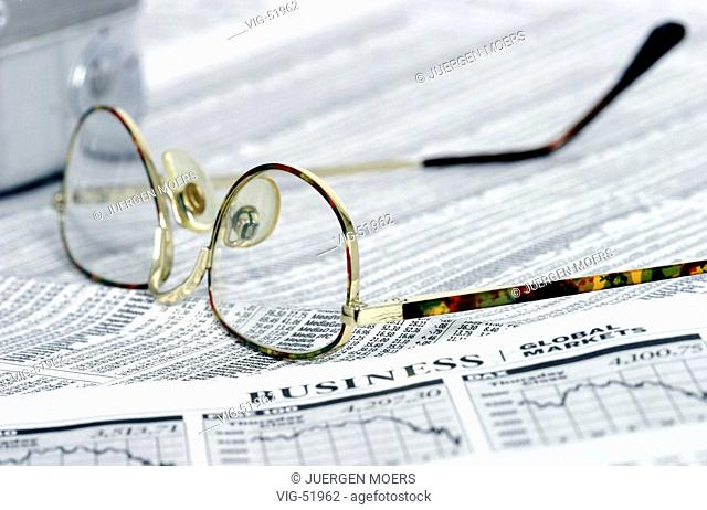 Glasses lying on the business part of a English / American daily newspaper. - 19/07/2003